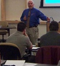 Photo of Pat Everly presenting to class